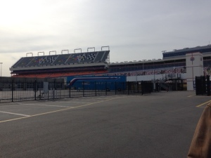 The decline in the economy has hurt the attendance at all speedways.  Attendance at CMS was around 97,000 at last count.  The stands pictured here, with the motor flags on them, have not been used since attendance has dwindled.  These seats are covered up with an American flag during race days.